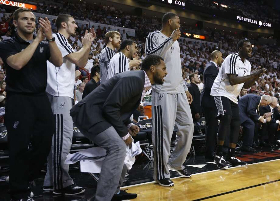 The Spurs bench reacts during second half action in Game 6 of the 2013 NBA Finals Tuesday, June 18, 2013 at American Airlines Arena in Miami. (Edward A. Ornelas/San Antonio Express-News)