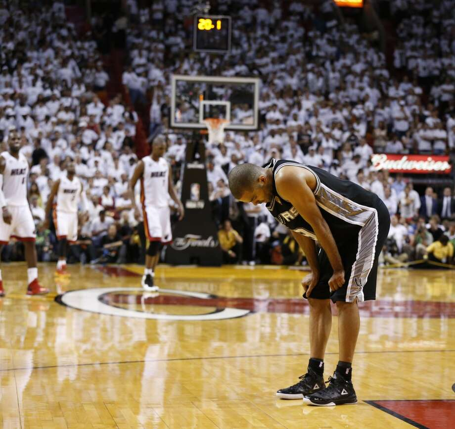 San Antonio Spurs' Tony Parker takes a moment to breath during the fourth quarter of Game 6 of the 2013 NBA Finals Tuesday, June 18, 2013 at American Airlines Arena in Miami. (Edward A. Ornelas/San Antonio Express-News)