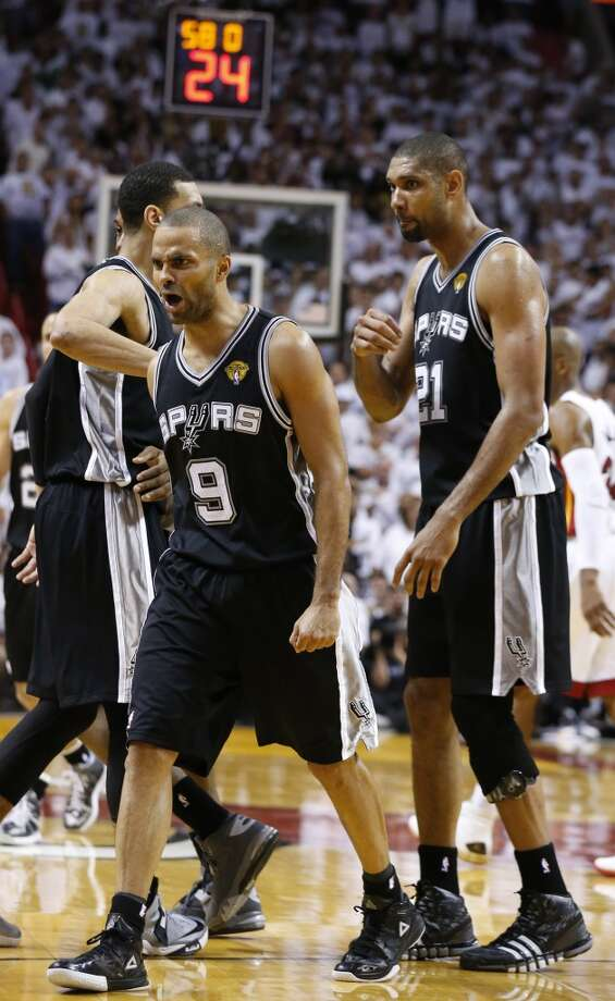 San Antonio Spurs' Tony Parker reacts as he walks off the court for a time out with 58 second left in regulation of during Game 6 of the 2013 NBA Finals Tuesday, June 18, 2013 at American Airlines Arena in Miami. (Edward A. Ornelas/San Antonio Express-News)