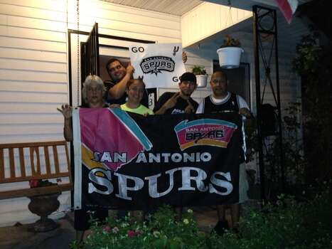 "Whenever the Spurs have win a game during Finals, Margie Sanchez can be seen marching down Buena Vista in front of her house holding her Spurs flag. But not tonight. ""It's not over yet,"" she said. ""I've been a Spurs fan all of my life and I really think they can win Game 7. I really do."" Photo: Daniella M. Diaz / San Antonio Express-News"