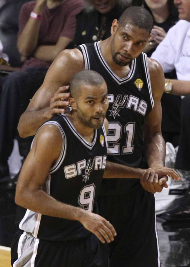San Antonio Spurs' Tim Duncan talks with teammate Tony Parker during the second half of Game 6 of the NBA Finals at American Airlines Arena on Tuesday, June 18, 2013 in Miami. (Kin Man Hui/San Antonio Express-News)