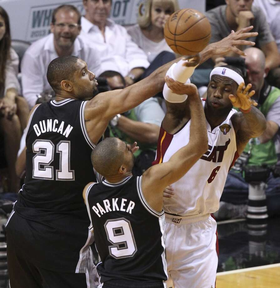 San Antonio Spurs' Tim Duncan and Tony Parker defend against Miami Heat's LeBron James during the second half of Game 6 of the NBA Finals at American Airlines Arena on Tuesday, June 18, 2013 in Miami. (Kin Man Hui/San Antonio Express-News)