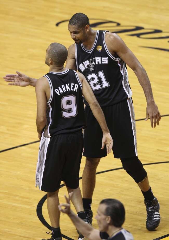 San Antonio Spurs' Tim Duncan reacts with Tony Parker during the second half of Game 6 of the NBA Finals at American Airlines Arena on Tuesday, June 18, 2013 in Miami. (Kin Man Hui/San Antonio Express-News)