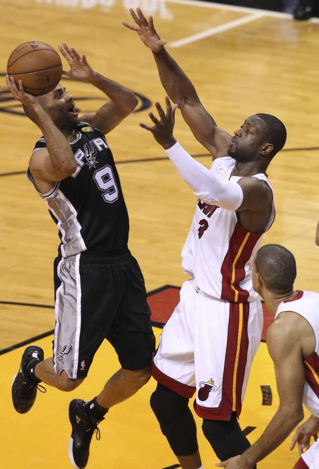 San Antonio Spurs' Tony Parker shoots over Miami Heat's Dwyane Wade during the second half of Game 6 of the NBA Finals at American Airlines Arena on Tuesday, June 18, 2013 in Miami. (Kin Man Hui/San Antonio Express-News)