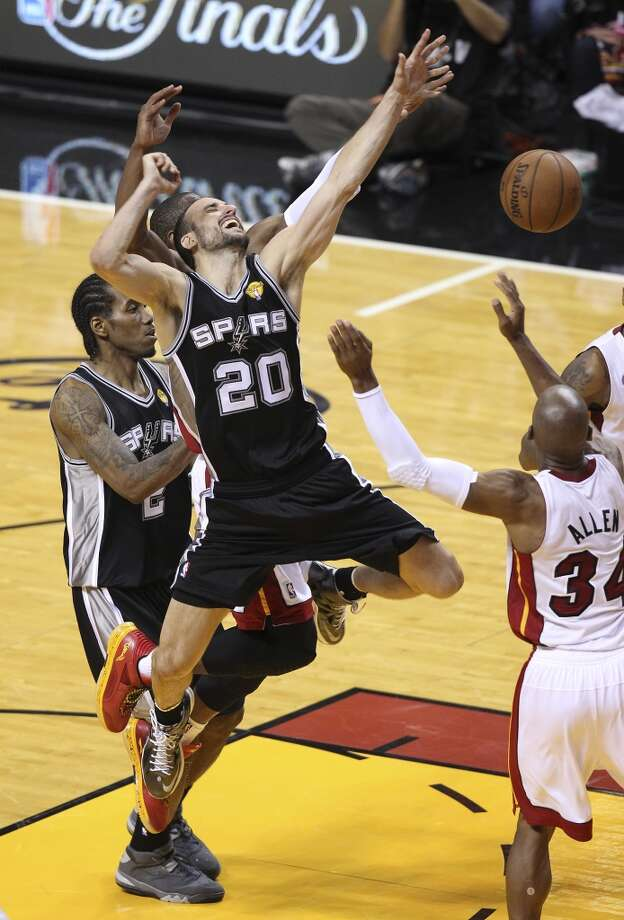 San Antonio Spurs' Manu Ginobili loses the ball to Miami Heat's Ray Allen during overtime of Game 6 of the NBA Finals at American Airlines Arena on Tuesday, June 18, 2013 in Miami. Spurs lose to the Heat, 103-100. (Kin Man Hui/San Antonio Express-News)