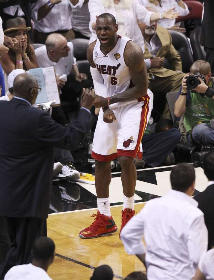 Miami Heat's LeBron James reacts after during overtime of Game 6 of the NBA Finals at American Airlines Arena on Tuesday, June 18, 2013 in Miami. (Kin Man Hui/San Antonio Express-News)