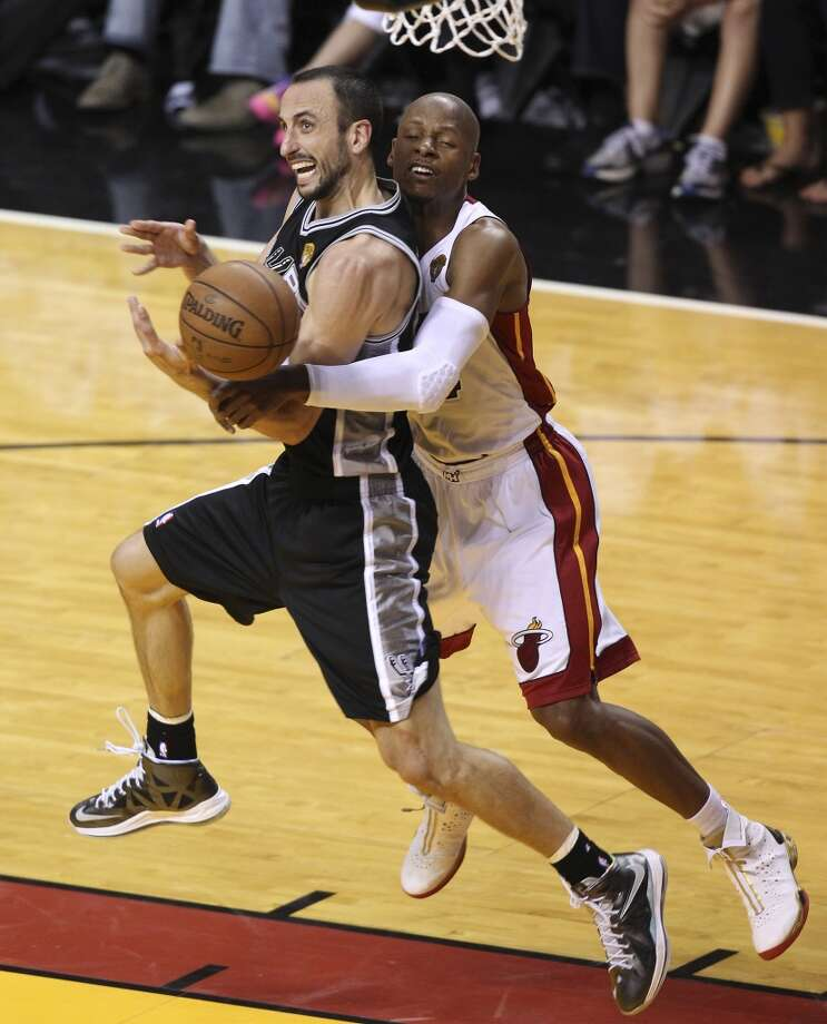 San Antonio Spurs' Manu Ginobili gets fouled by Miami Heat's Ray Allen during the second half of Game 6 of the NBA Finals at American Airlines Arena on Tuesday, June 18, 2013 in Miami. (Kin Man Hui/San Antonio Express-News)