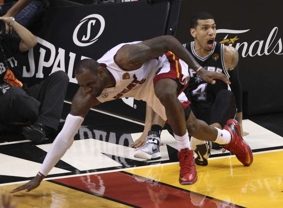 San Antonio Spurs' Danny Green reacts after colliding with Miami Heat's LeBron James during overtime of Game 6 of the NBA Finals at American Airlines Arena on Tuesday, June 18, 2013 in Miami. (Kin Man Hui/San Antonio Express-News)