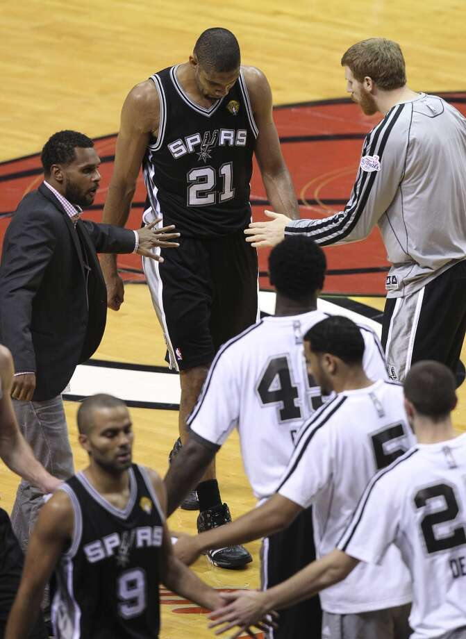 San Antonio Spurs' Tim Duncan hangs his head after failing to close out Game 6 of the NBA Finals at American Airlines Arena on Tuesday, June 18, 2013 in Miami. Spurs lost 103-100. (Kin Man Hui/San Antonio Express-News)