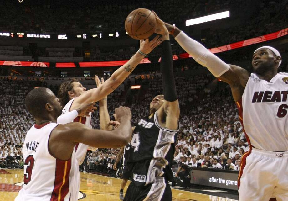 San Antonio Spurs' Danny Green attempts a shot against Miami Heat's Dwyane Wade, Mike Miller and LeBron James during the first half of Game 6 of the NBA Finals at American Airlines Arena on Tuesday, June 18, 2013 in Miami. (Kin Man Hui/San Antonio Express-News)