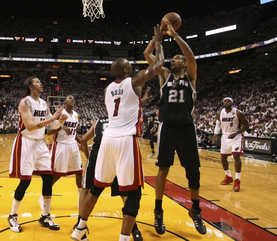San Antonio Spurs' Tim Duncan attempts a shot against Miami Heat's Chris Bosh during the first half of Game 6 of the NBA Finals at American Airlines Arena on Tuesday, June 18, 2013 in Miami. (Kin Man Hui/San Antonio Express-News)