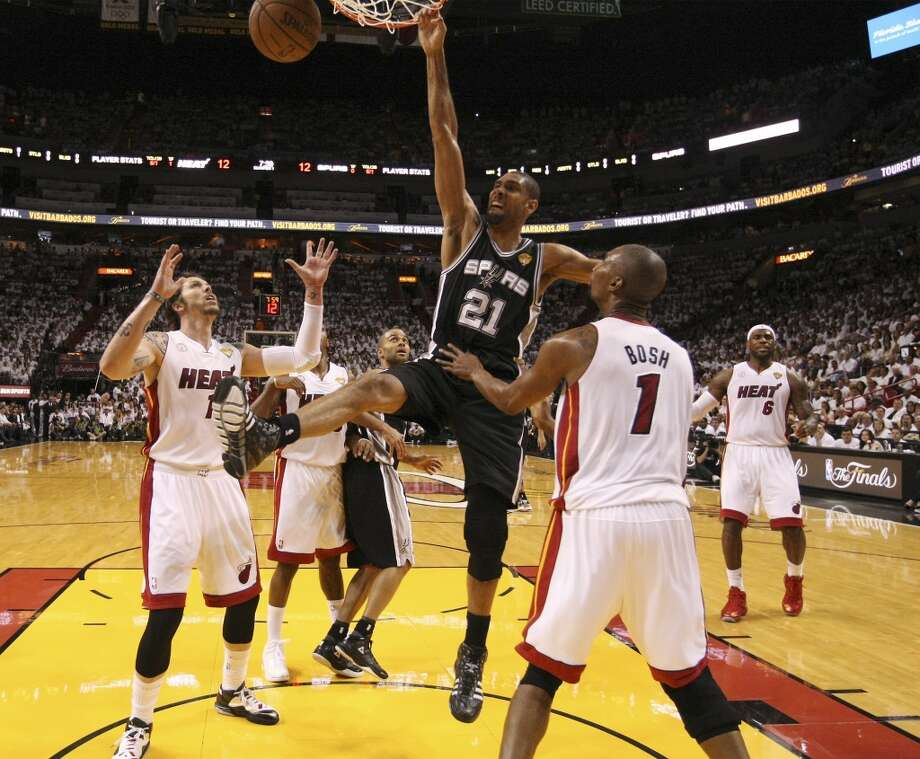 San Antonio Spurs' Tim Duncan dunks against Miami Heat's Chris Bosh and Mike Miller during the first half of Game 6 of the NBA Finals at American Airlines Arena on Tuesday, June 18, 2013 in Miami. (Kin Man Hui/San Antonio Express-News)