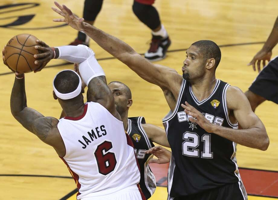 Miami Heat's LeBron James tries to dish to a teammate while being defended by San Antonio Spurs' Tony Parker and Tim Duncan during the second half of Game 6 of the NBA Finals at American Airlines Arena on Tuesday, June 18, 2013 in Miami. (Jerry Lara/San Antonio Express-News)