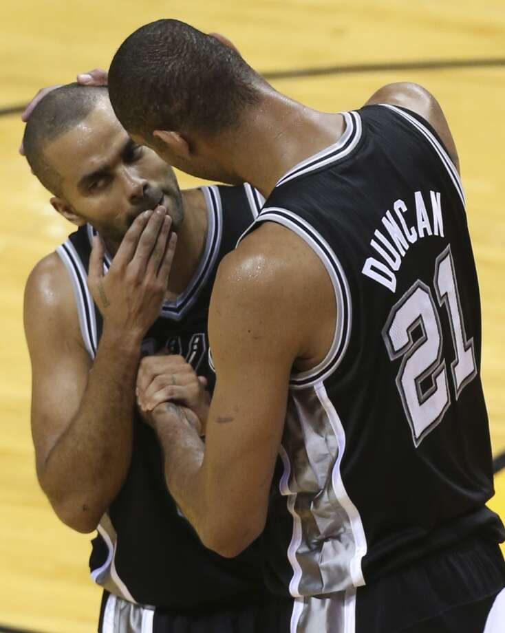San Antonio Spurs' Tim Duncan looks at team ate Tony Parker after he collided with a Heat player during the second half of Game 6 of the NBA Finals at American Airlines Arena on Tuesday, June 18, 2013 in Miami. (Jerry Lara/San Antonio Express-News)