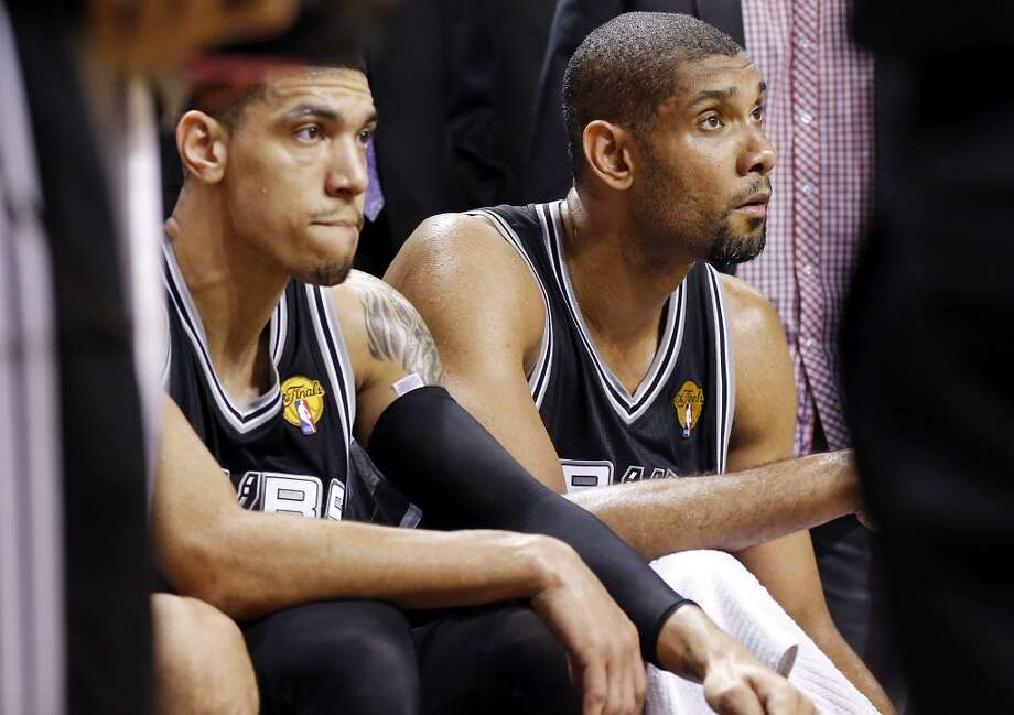 San Antonio Spurs' Danny Green and San Antonio Spurs' Tim Duncan sit on the bench late in overtime action in Game 6 of the 2013 NBA Finals against the Miami Heat Tuesday, June 18, 2013 at American Airlines Arena in Miami. The Heat won 103-100. (Edward A. Ornelas/San Antonio Express-News)