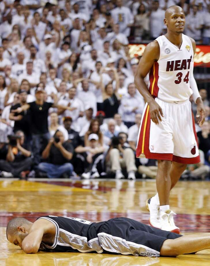 San Antonio Spurs' Tony Parker lies on the floor after a play as Miami Heat's Ray Allen looks on during overtime during Game 6 of the 2013 NBA Finals Tuesday, June 18, 2013 at American Airlines Arena in Miami. (Edward A. Ornelas/San Antonio Express-News)