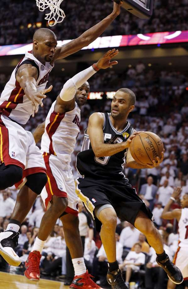 San Antonio Spurs' Tony Parker looks to pass around Miami Heat's Chris Bosh and Miami Heat's LeBron James during overtime during Game 6 of the 2013 NBA Finals Tuesday, June 18, 2013 at American Airlines Arena in Miami. (Edward A. Ornelas/San Antonio Express-News)