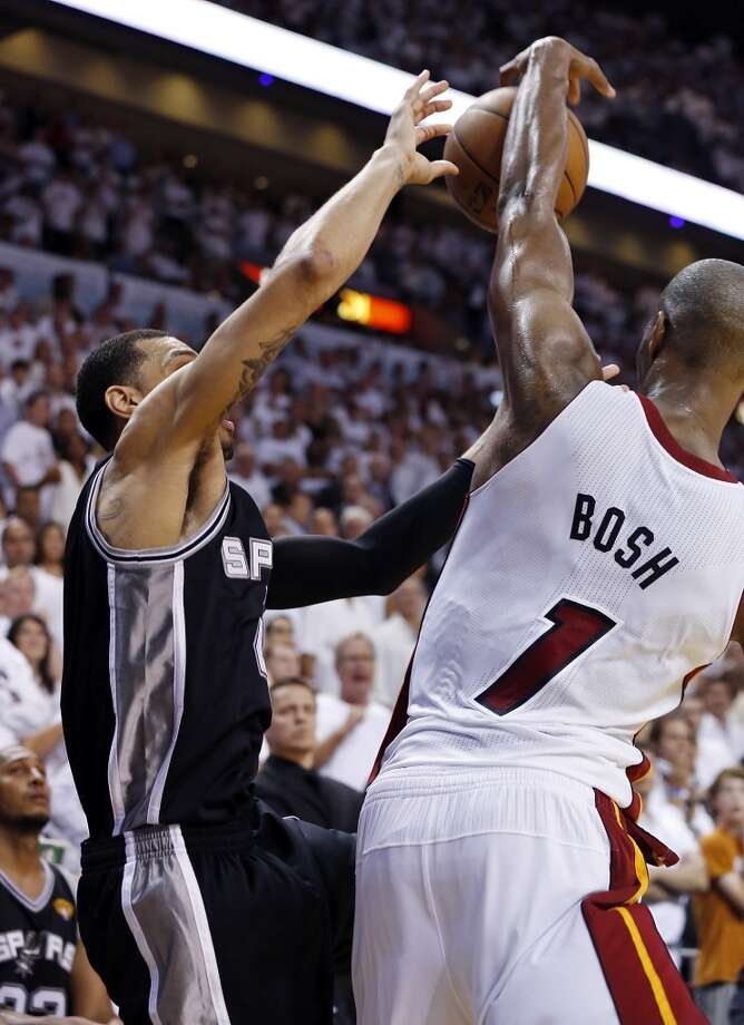 Miami Heat's Chris Bosh blocks the final shot by San Antonio Spurs' Danny Green during overtime action in Game 6 of the 2013 NBA Finals Tuesday, June 18, 2013 at American Airlines Arena in Miami. The Heat won 103-100. (Edward A. Ornelas/San Antonio Express-News)