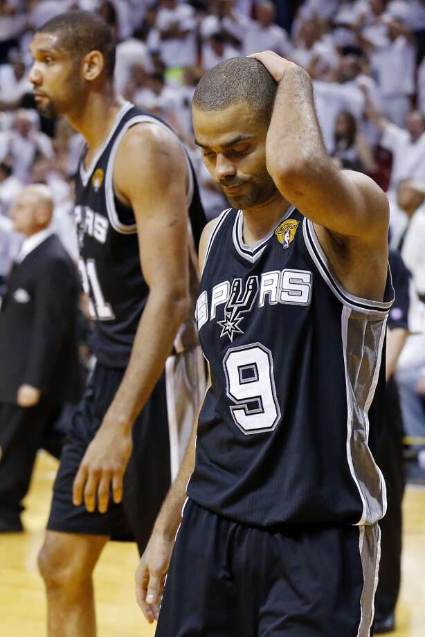 San Antonio Spurs' Tim Duncan and San Antonio Spurs' Tony Parker walk off the court during a timeout in overtime action in Game 6 of the 2013 NBA Finals against the Miami Heat Tuesday, June 18, 2013 at American Airlines Arena in Miami. (Edward A. Ornelas/San Antonio Express-News)