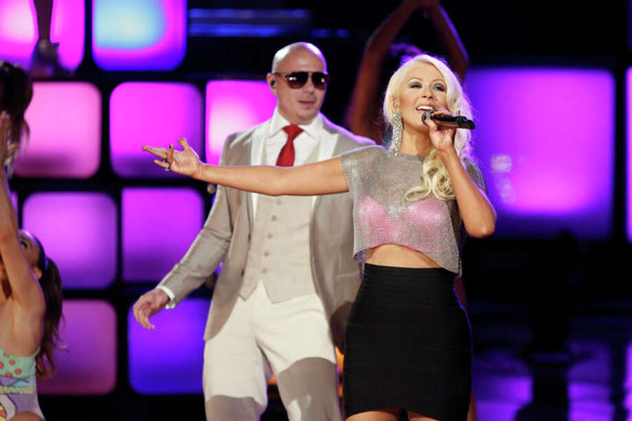 "THE VOICE -- Episode 419B ""Live Finale"" -- Pictured: (l-r) Pitbull, Christina Aguilera -- Photo: NBC, Tyler Golden/NBC / 2013 NBCUniversal Media, LLC"