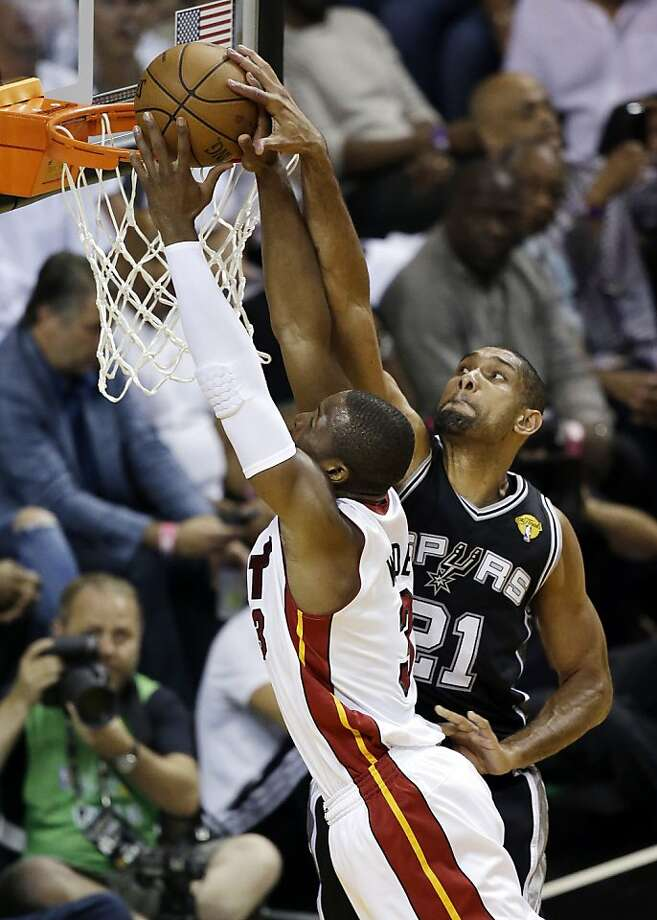 San Antonio Spurs forward Tim Duncan (21) blocks a shot by Miami Heat shooting guard Dwyane Wade (3) during the first half of Game 6 of the NBA Finals basketball game, Tuesday, June 18, 2013 in Miami. (AP Photo/Wilfredo Lee) Photo: Wilfredo Lee, Associated Press