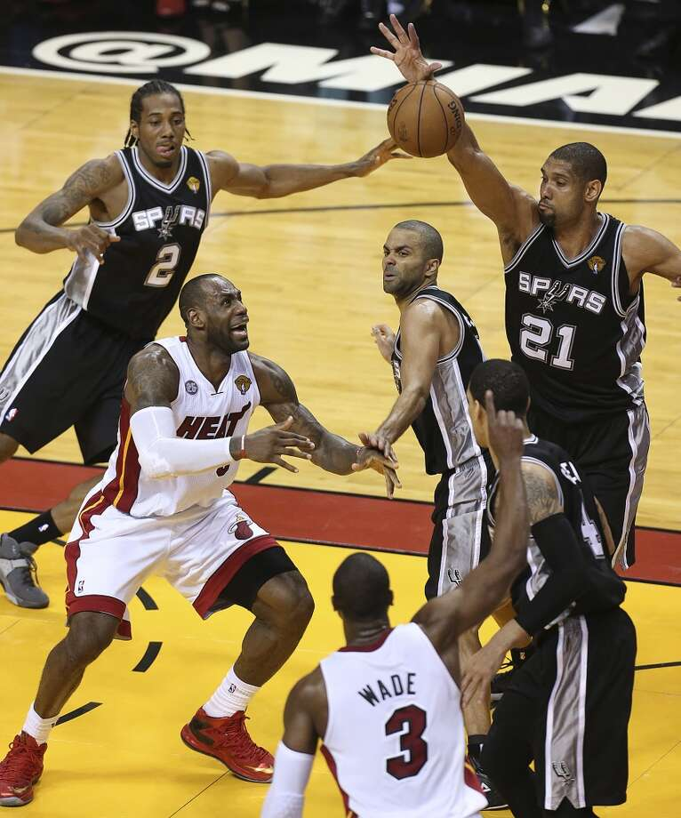 Miami Heat's LeBron James loses the ball under pressure from San Antonio Spurs' Kawhi Leonard, Tony Parker and Tim Duncan during the 4th quarter of Game 6 of the NBA Finals at American Airlines Arena on Tuesday, June 18, 2013 in Miami. (Jerry Lara/San Antonio Express-News)