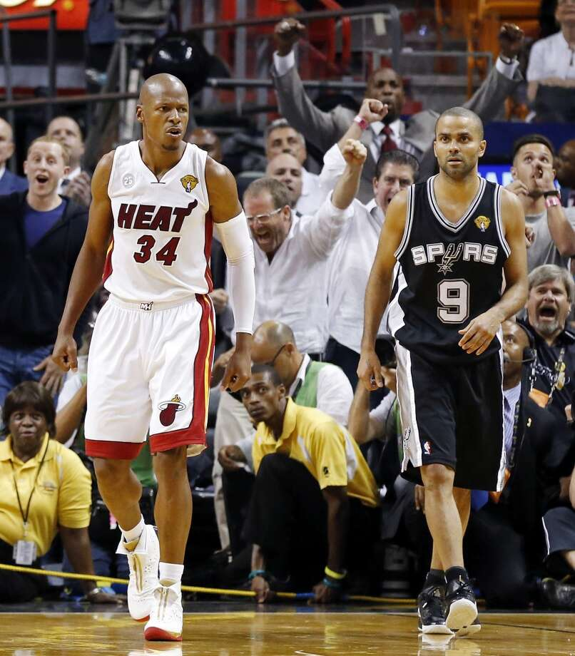 Miami Heat's Ray Allen reacts after making a 3-pointer to tie the game late in the fourth quarter as San Antonio Spurs' Tony Parker looks on in Game 6 of the 2013 NBA Finals Tuesday, June 18, 2013 at American Airlines Arena in Miami. (Edward A. Ornelas/San Antonio Express-News)