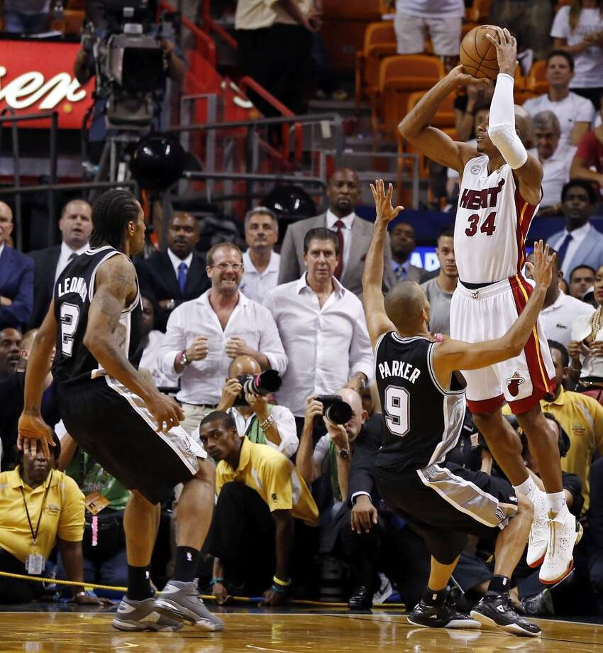 Miami Heat's Ray Allen shoots a 3-pointer to tie the game late in the fourth quarter over San Antonio Spurs' Tony Parker as San Antonio Spurs' Kawhi Leonard looks on in Game 6 of the 2013 NBA Finals Tuesday, June 18, 2013 at American Airlines Arena in Miami. (Edward A. Ornelas/San Antonio Express-News)