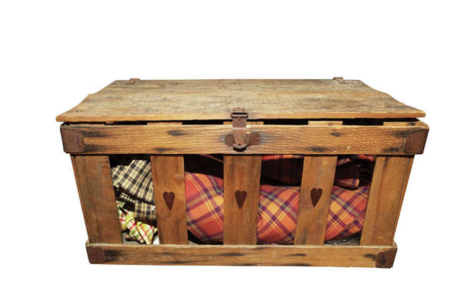Fruit CrateThis sturdy, rustic old fruit crate can do double duty, acting as a storage bin and coffee table at the same time. Available from E-Barn Country Store. $25.