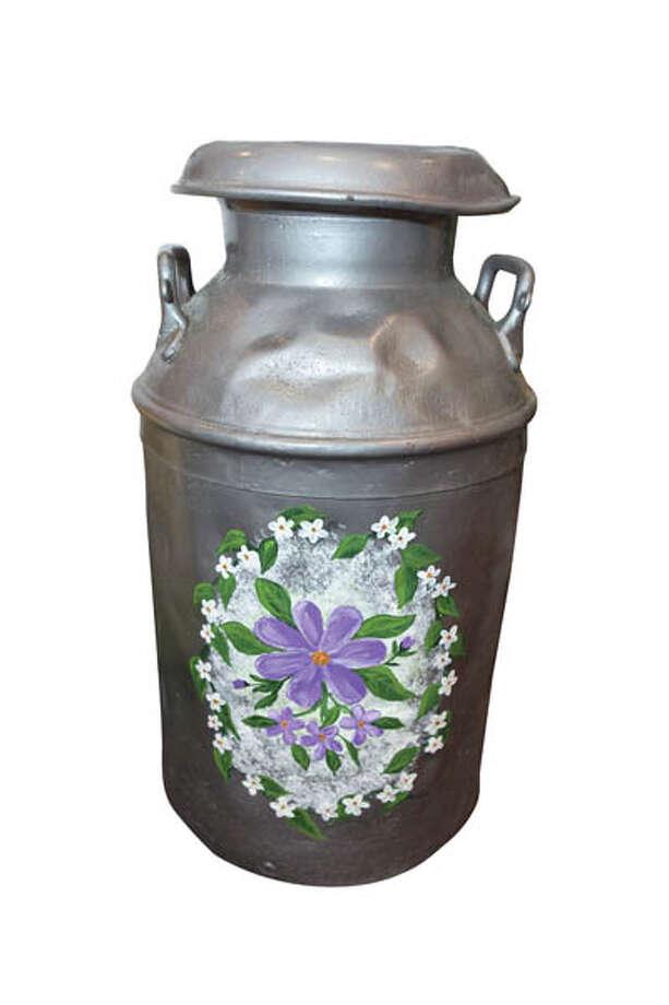 Antique Milk Can When is a milk can more than a milk can? When you paint it and make it a lovely accent piece. This decorative can is available from Albany-based Mary's Marvels (Mary Holmes). $40.