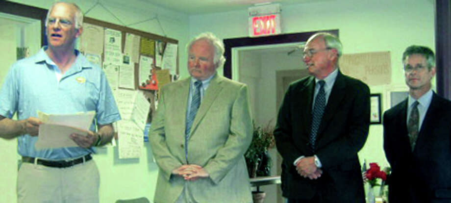 Kent First Selectman Bruce Adams, left, addresses the turnout at the Kent Senior Center on hand to witness the signing of an agreement with the local preparatory high schools to help fund a state policeman for the town. Joining him are, from left to right, of the Rev. Richardson W. Schell, headmaster of Kent School, Arthur F. Goodearl Jr., head of school at Marvelwood School and Andrew J. Vadnais, head of school at South Kent School. May 2013 Photo: Norm Cummings