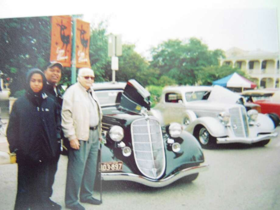 Shown are Stanley D. Young (front), the second owner of the 1935 Hudson, taken at the Boerne car show, with him are Kevin Smith (present owner) and his son, Darnell Smith. / Copyright 2009