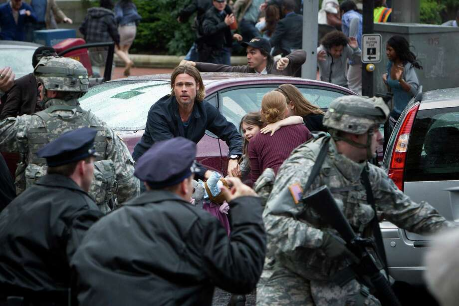 "Brad Pitt's character takes center stage in the zombie thriller ""World War Z."" Photo: Jaap Buitendijk, Stills Photographer / © 2011 Paramount Pictures.  All Rights Reserved."