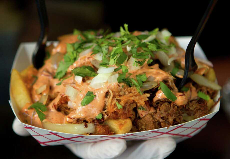 Coreanos food truck review Friday, Nov. 2, 2012, in Houston. (Cody Duty / Houston Chronicle) Photo: Cody Duty, Staff / © 2012 Houston Chronicle
