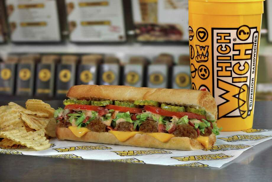 Which Wich Superior Sandwiches has launched the Bacon Cheeseburger Astrowich. The sandwich -- piled with meat, cheese, bacon and other classic burger toppings -- is available now through Aug. 31 at all 25 Houston-area Which Wich locations. Photo: Courtesy Photo