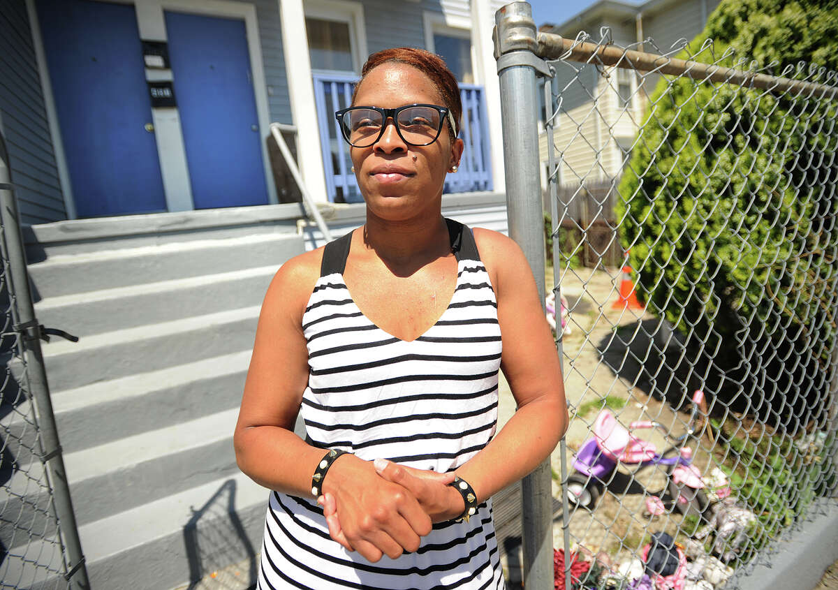Ebony Harper stands outside her Brooks Street home, in Bridgeport, Conn., where a 15-year-old girl was shot last year. Harper, whose story is shared in the film