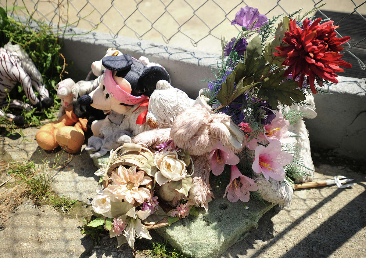 The weather worn memorial for a 15-year-old girl shot last year outside Ebony Harper's home, on Brooks Street in Bridgeport, Conn. on Wednesday, June 19, 2013.