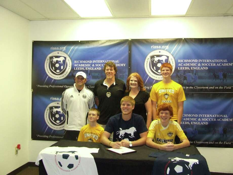 Pictured in the front row from left to right brother Micah Jenkins, Caleb Jenkins and brother Noah Jenkins. In the second row from left to right is Jay Sparrow of SA United Soccer Club, parents Shane and Peggy and brother Isaac. Photo: Pat Turner / Bulverde News