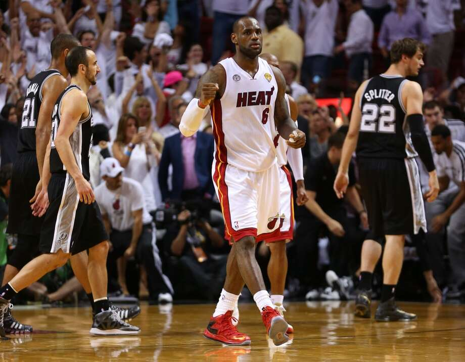 Heat forward LeBron James reacts against the Spurs.