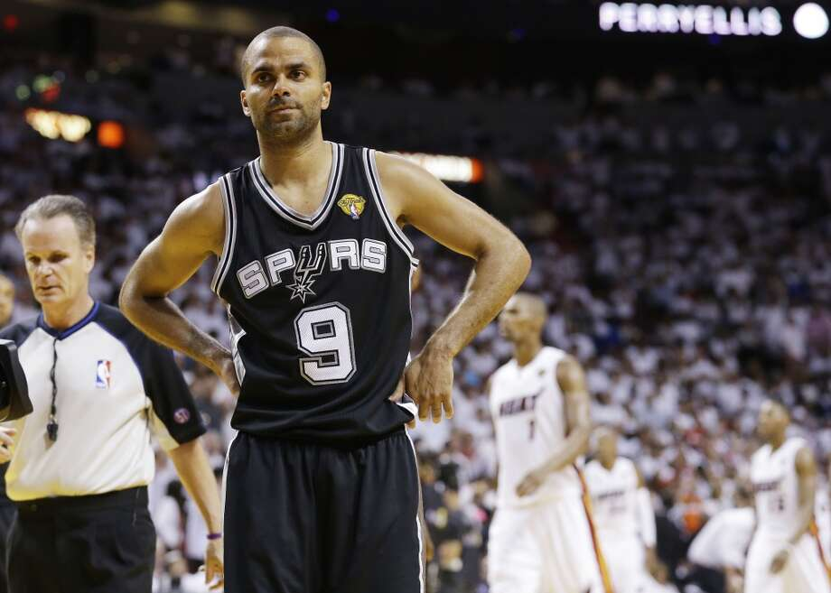Spurs point guard Tony Parker reacts during overtime.