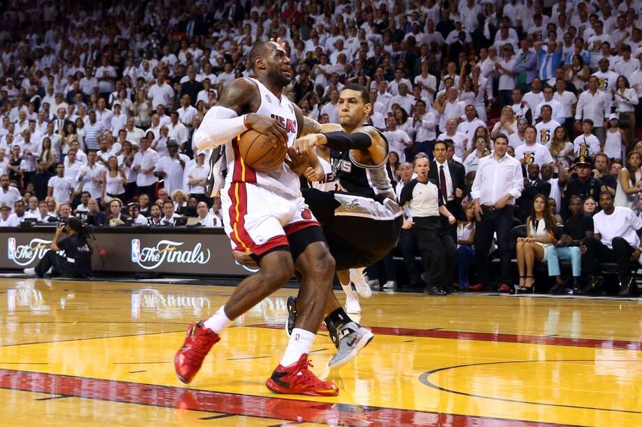 Danny Green of the Spurs defends LeBron James of the Heat.