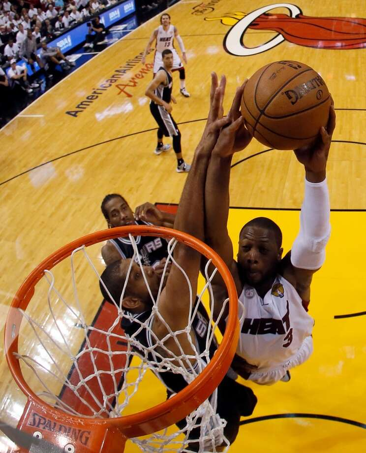Heat guard Dwyane Wade puts down a dunk against the Spurs.