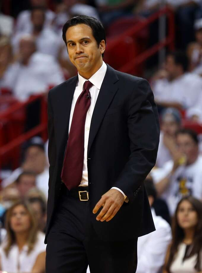 Heat coach Erik Spoelstra looks on as his team plays the Spurs.