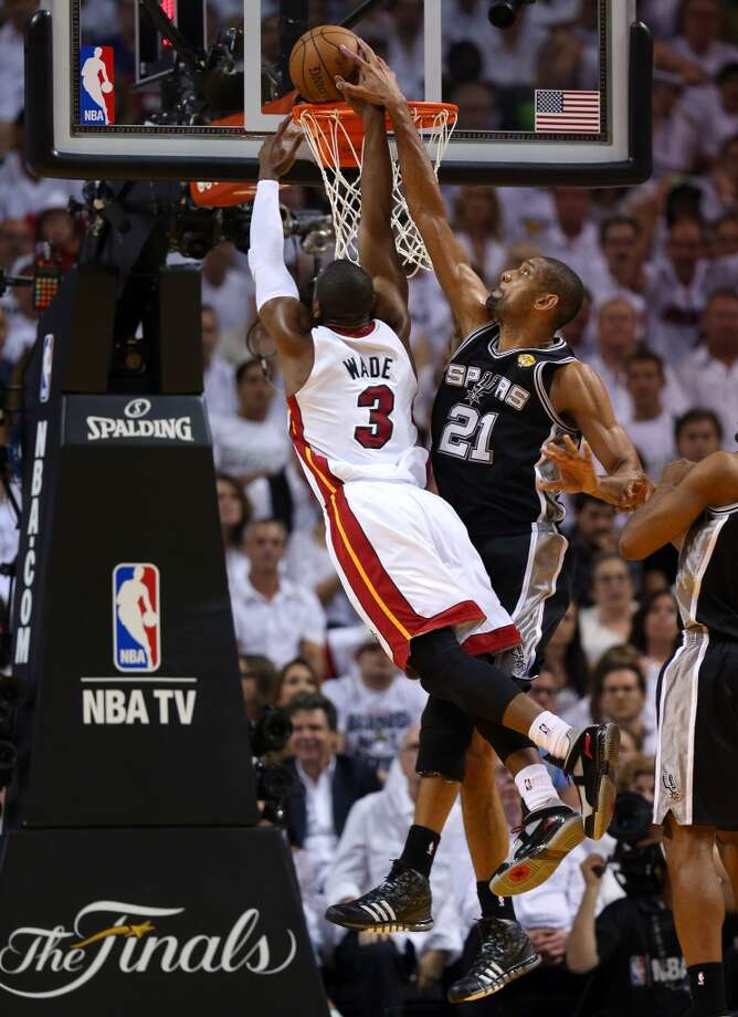 Dwyane Wade of the Heat makes a dunk against the Spurs.