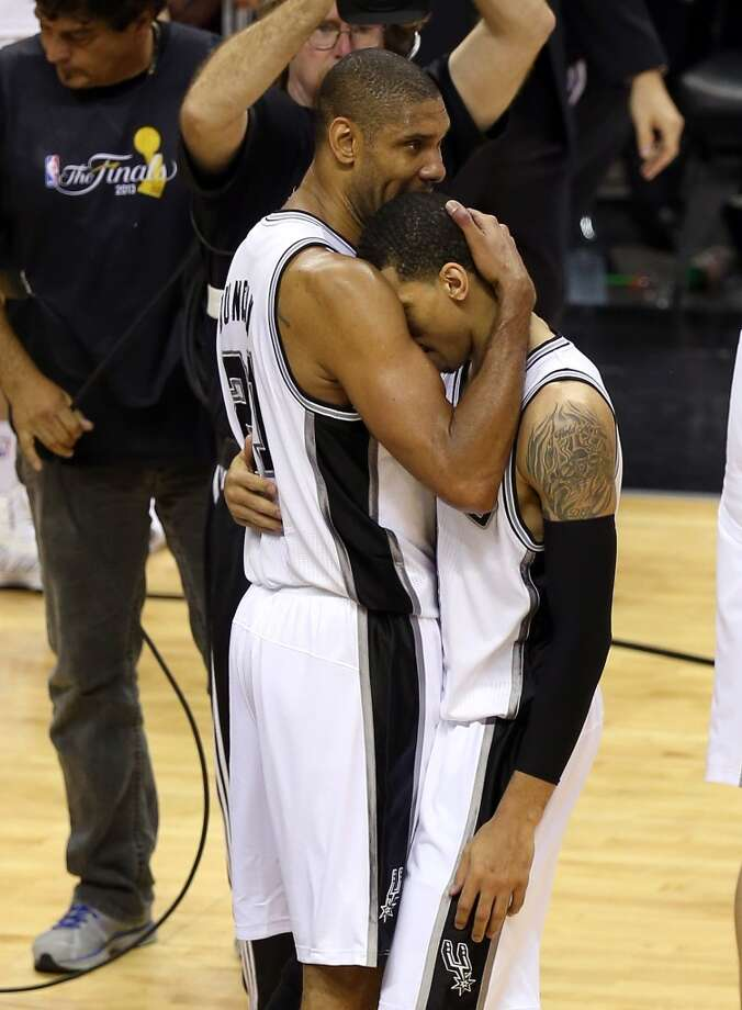 June 16: Game 5 - Spurs 114, Heat 104Tim Duncan hugs Danny Green after the Spurs victory in Game 5.
