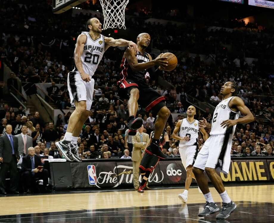 Ray Allen goes up for a shot against Manu Ginobili.