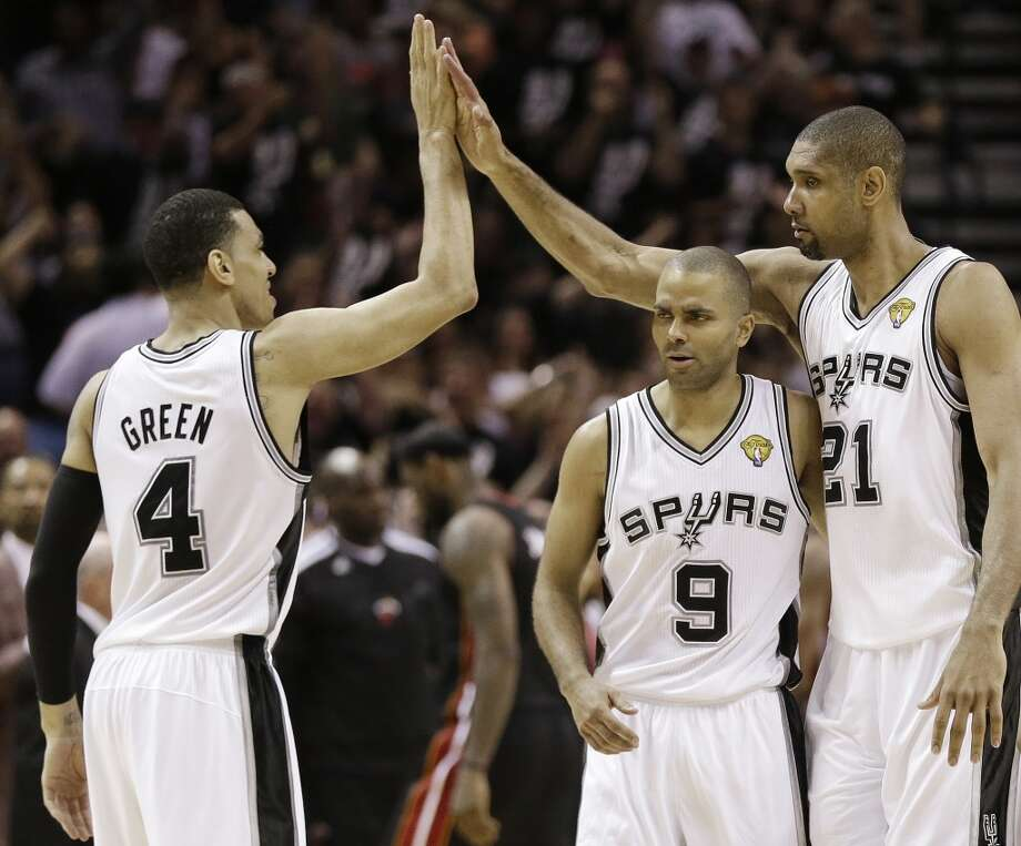 Danny Green, Tony Parker and Tim Duncan react during the second half.