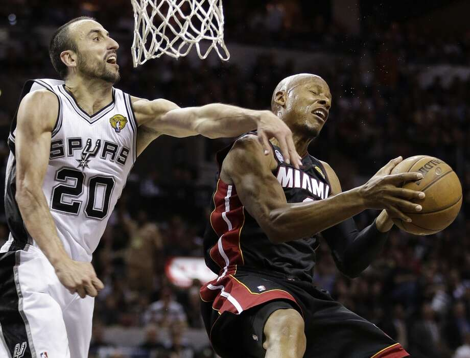 Ray Allen tries to shoot against Manu Ginobili.