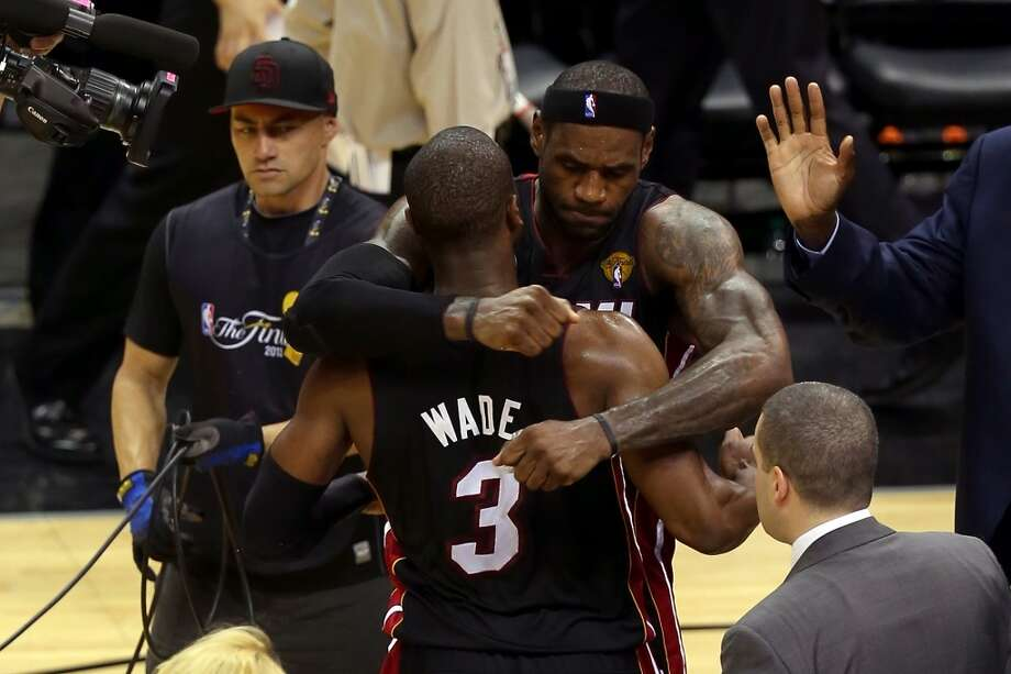 LeBron James hugs Dwyane Wade.