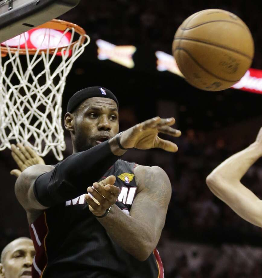 LeBron James passes against the Spurs during the second half.